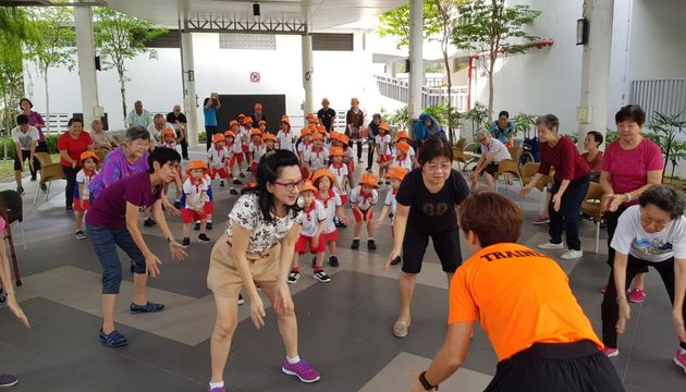 Exercising with Ah Ma and Ah Gong of Senior Pacific Activity Centre