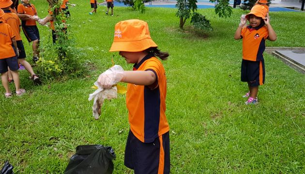 Picking up litter for our environment.